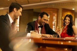 three people gambling